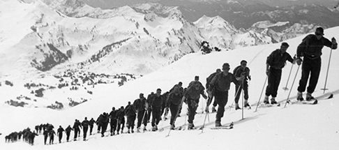 Mountain Shop builds metal-edged skis, ice axes, crampons, backpacks for soldiers in the 10th Mountain Division for WWII.